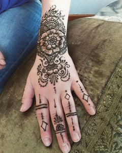 Henna on the hand with rings - henna designs for the hand and wrist, henna michigan