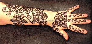 henna tattoo arm design, kelly caroline, flowers