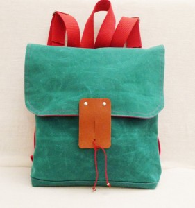 green, canvas backpack