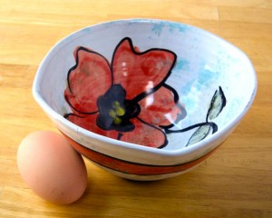 red poppy, clay bowl