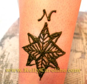 henna compass tattoo