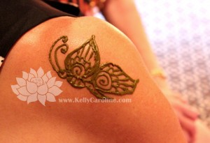 butterfly henna design on shoulder
