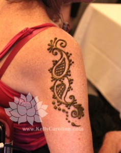 paisley henna design on arm