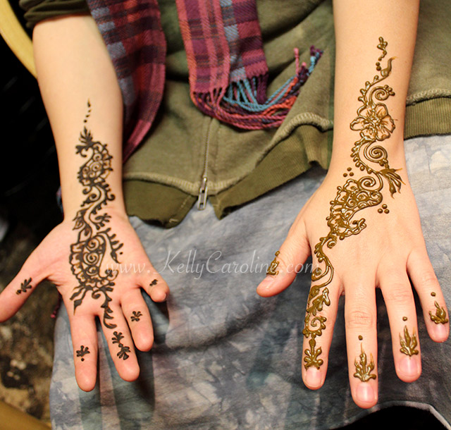 henna tattoos on the palm and top of hands