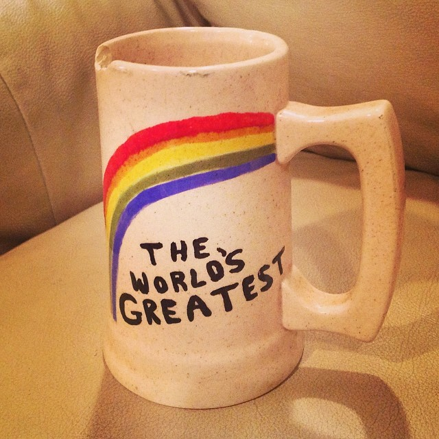 "My greatest Salvation Army find. A hand made and painted clay mug with the words ""Merry Christmas Dad Love, Linda"" etched in the bottom. Obviously the best part is that it is left so ambiguous …. The World's Greatest… ?? what?? . Love it.#worldsgreatest #happyfathersday #mug #clay #art #thriftstore #salvationarmy #kellycaroline #artist #rainbow #handmade #glaze #gift #love"