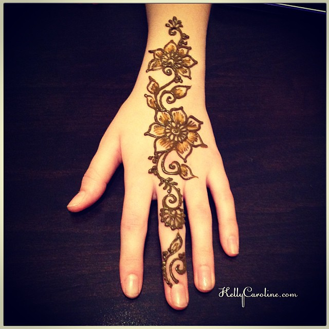 A new Henna design for the top of the hand. She asked for something simple and floral, and this is what I did for her. She really liked it