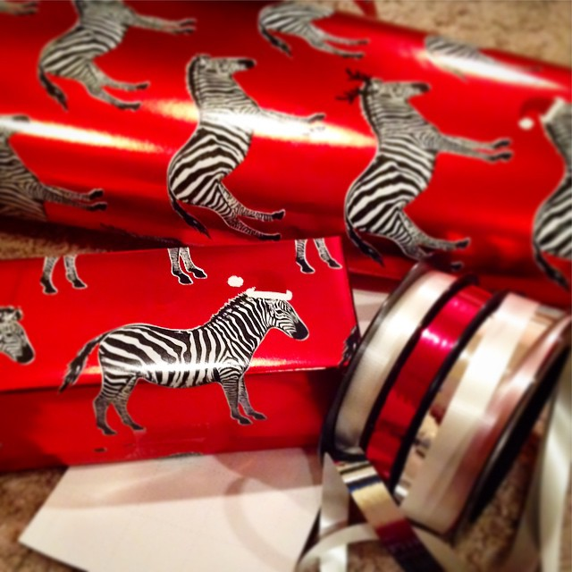 The best wrapping paper :: from my husband #zebras #wrappingpaper #santa #christmas #2014 #ypsi #ypsilanti #kellycaroline #michigan #gifts #ribbon #red #blackandwhite #classy #metallic #hats #animals #wild