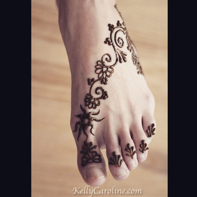 And a cute little foot design for a girl's first time having henna done. She wanted simple flowers and a sun design