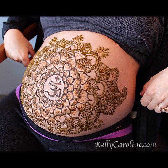 Hannah baby belly design with a mandala and OM -so fun! She wanted a symmetrical henna design with the OM in the center.