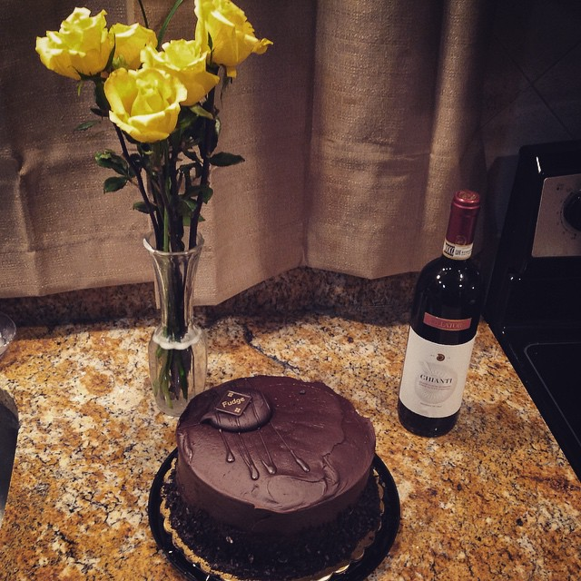 Not only does my husband do the grocery shopping for me, ((since it is my least favorite errand)) this is what he brings home.. Very blessed  #chocolate #roses #yellow #wine #cake #love #newhouse