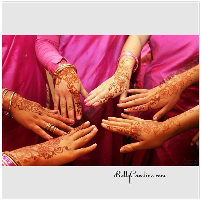 Henna designs on the hands for this beautiful fusion wedding. I love their magenta saris! So glam
