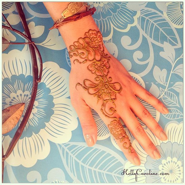 A cute Henna design on the top of the hand.