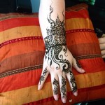henna tattoo on the top of the hand