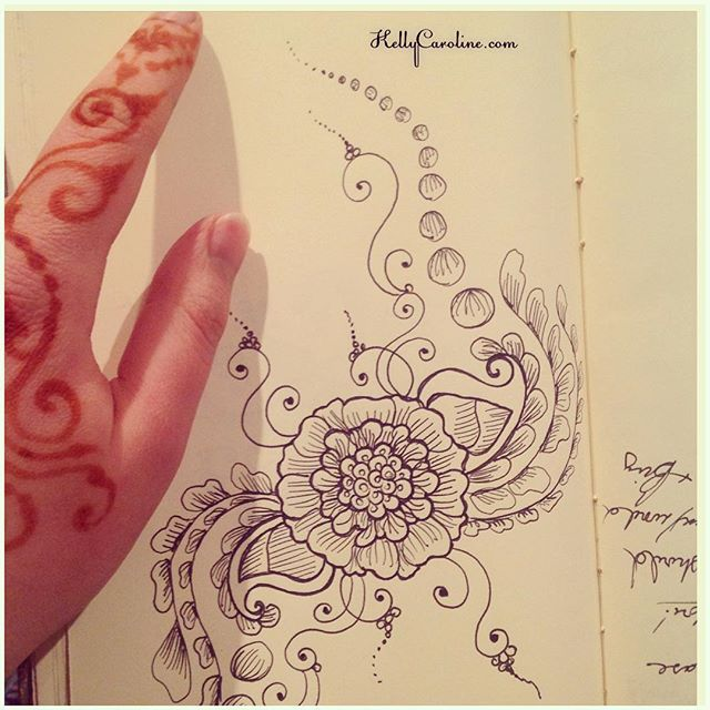 A picture with a little henna stain on my hands. A little vine action showcasing a new mandala henna design from my sketchbook last night