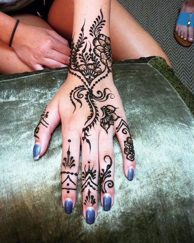 A fun vine henna hand design in the studio ::