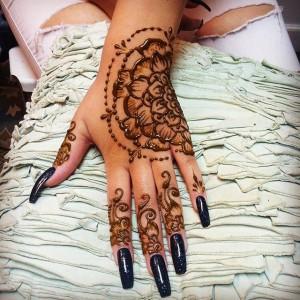 Hand henna with half mandala henna designs. henna michigan